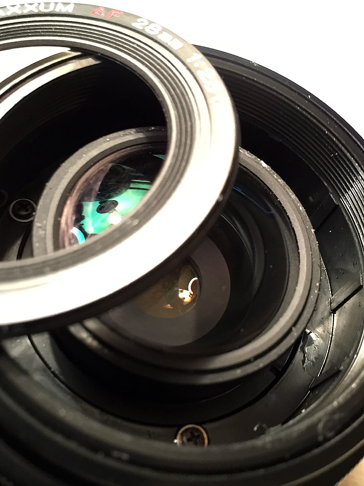 Minolta 28mm f/2.8 - Front of the lens with cover ring removed.