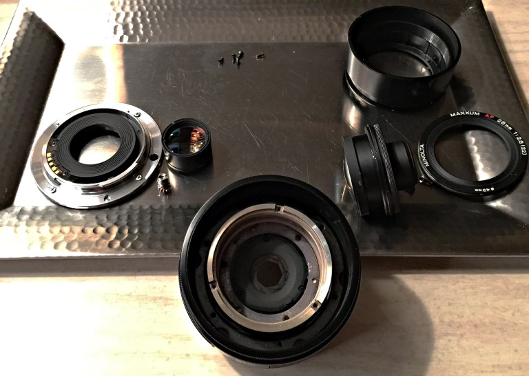 Minolta 28mm /f2.8 - The lens disassembled front and rear.  Aperture assembly remains in the lens barrel.